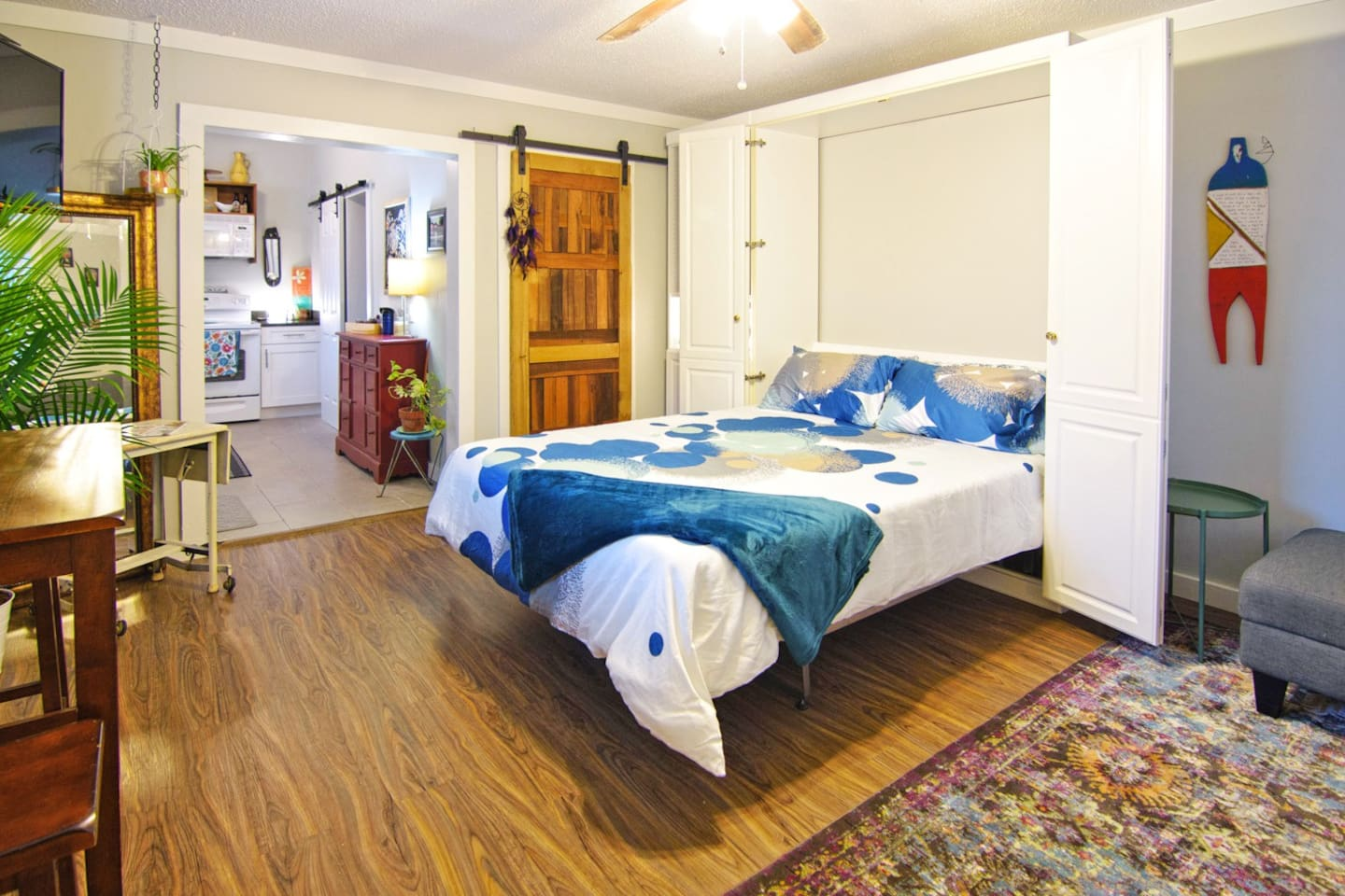 This studio apartment is cozy and spacious. The Queen sized Murphy bed is easy to pull down or hideaway (our grandson calls it the transformer house). In the adjoining attached bookcase find the iron & board and blowdryer, or use to hang clothes