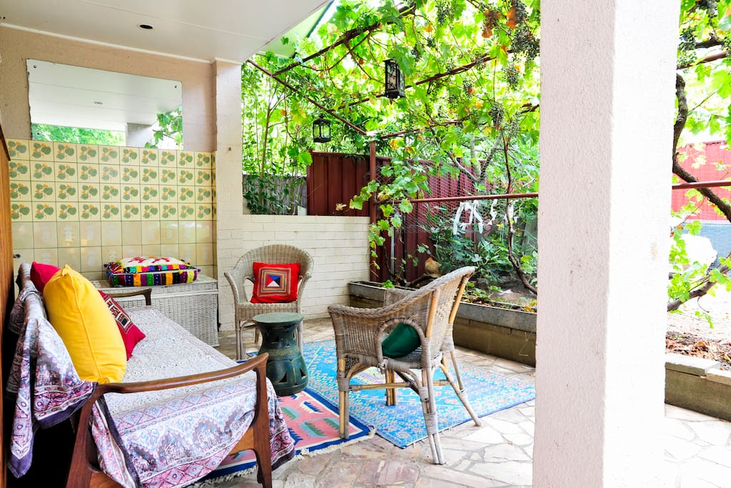 The adjacent vine-trellised pergola is available for guests' use.