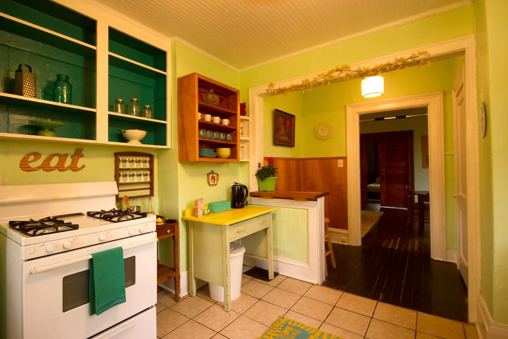 freshly painted fully equipped kitchen, new ceiling and ceiling fan! Clean, breezy, light filled!