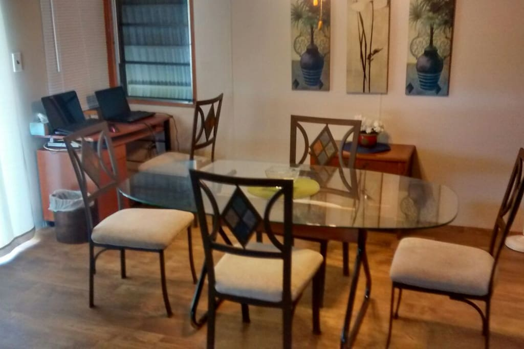 Dining room has seating for 6 plus a desk for those who need a mini work area.