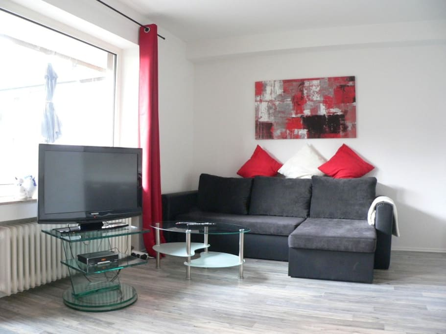 Blick in Wohnraum TV und Wifi free