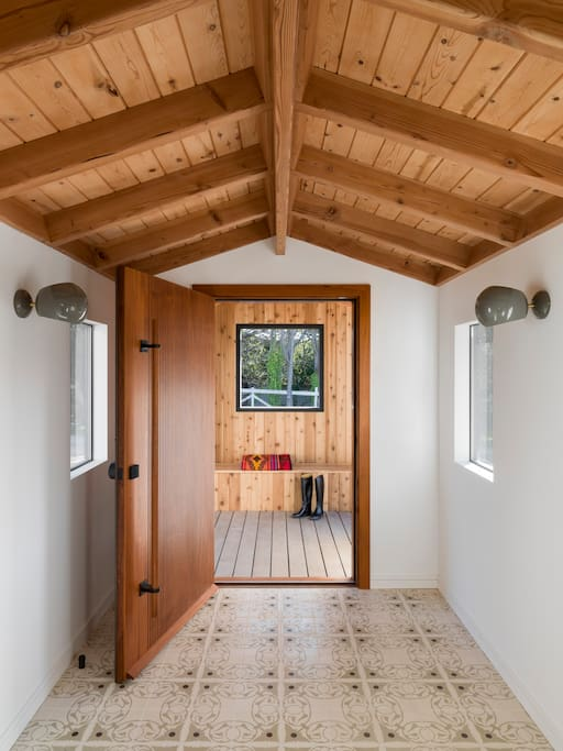 The front porch opens to a mud room for guests to remove their shoes