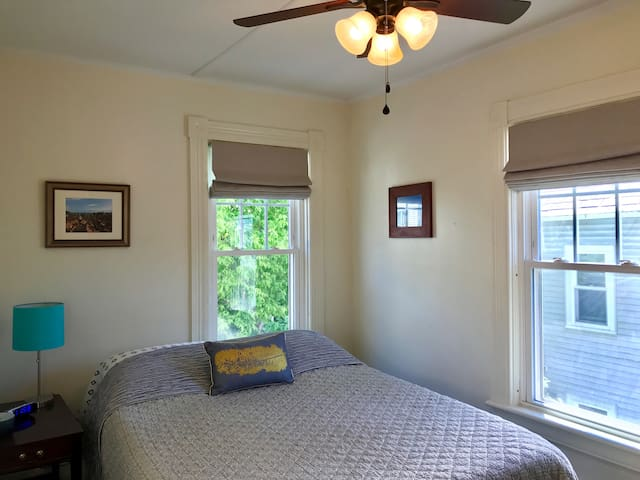The Double Bedroom features a ceiling fan and custom blackout shades. Window a/c unit is provided between Memorial Day and Labor Day