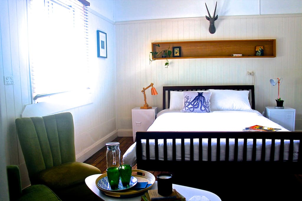 Bedroom 1: Queen bed, comfy sitting area, desk, full size wardrobe, private ensuite.