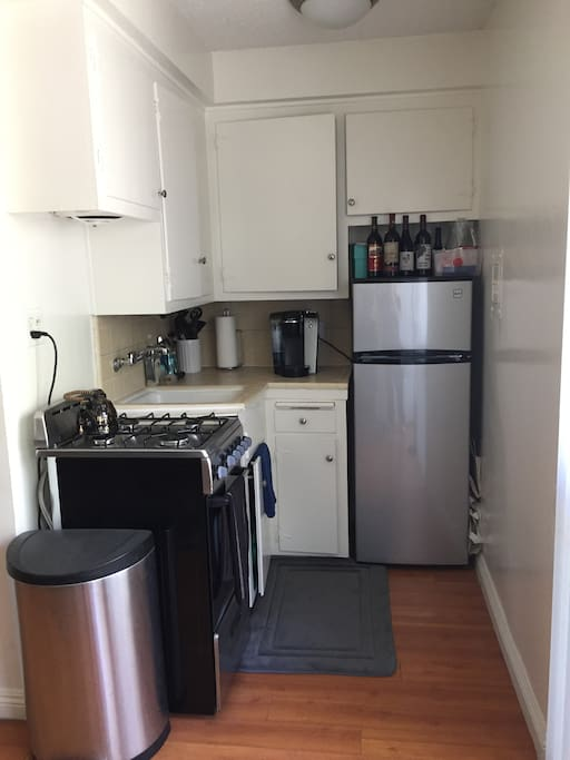 Kitchen is small but has all the amenities you will need to include stove, refrigerator, microwave, and  Keurig. All silverware and cookware are able to be used.