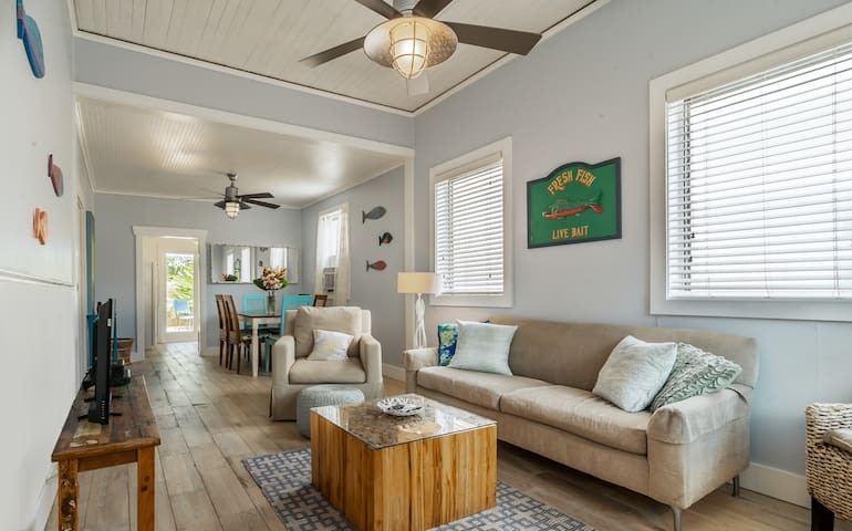 Open plan living/dining with tall ceilings,  reclaimed oak wood floors