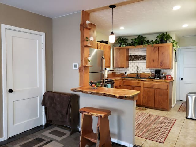 Remodeled kitchen with locally harvested Alligator Juniper wood. This wood was taken from dead & down trees right in the community!