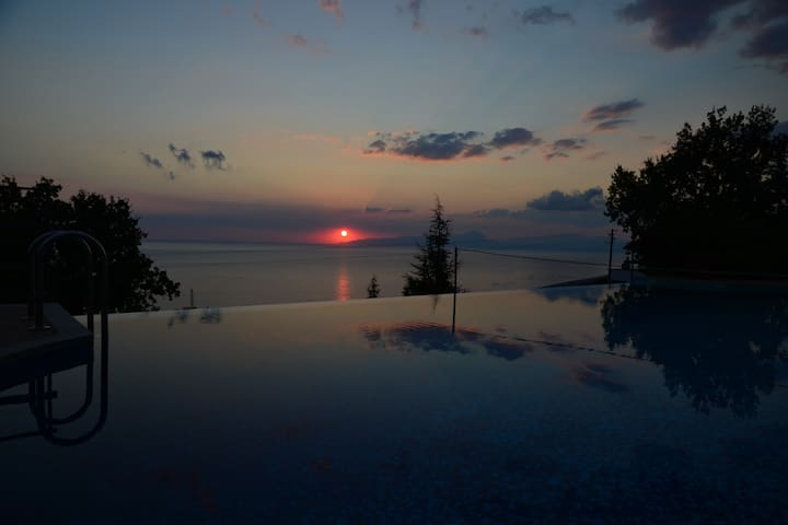 Sunset over the pool and Mediterranean