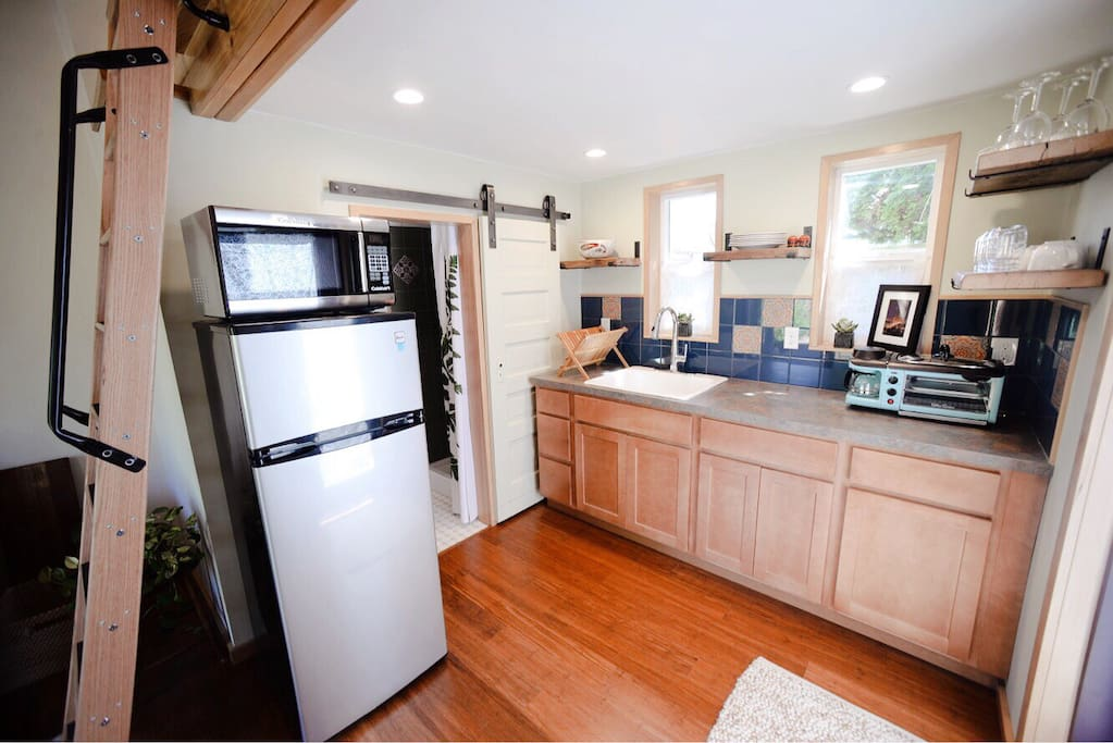 Cute full kitchen, minus a large oven: Portable Induction burner stove top with pans/pots, toaster oven with coffee maker and grill, microwave and espresso machine! (Fair trade organic coffee too.)