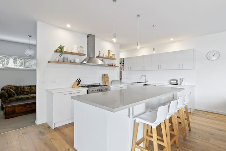 Stunning and spacious light filled kitchen which wraps around the back ad looks out to the living dining rooms as well as the  veranda