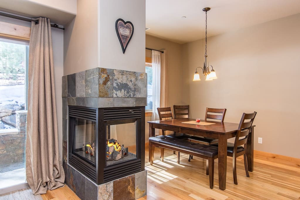 Enjoy a gas fireplace by the dining area in the open living space.