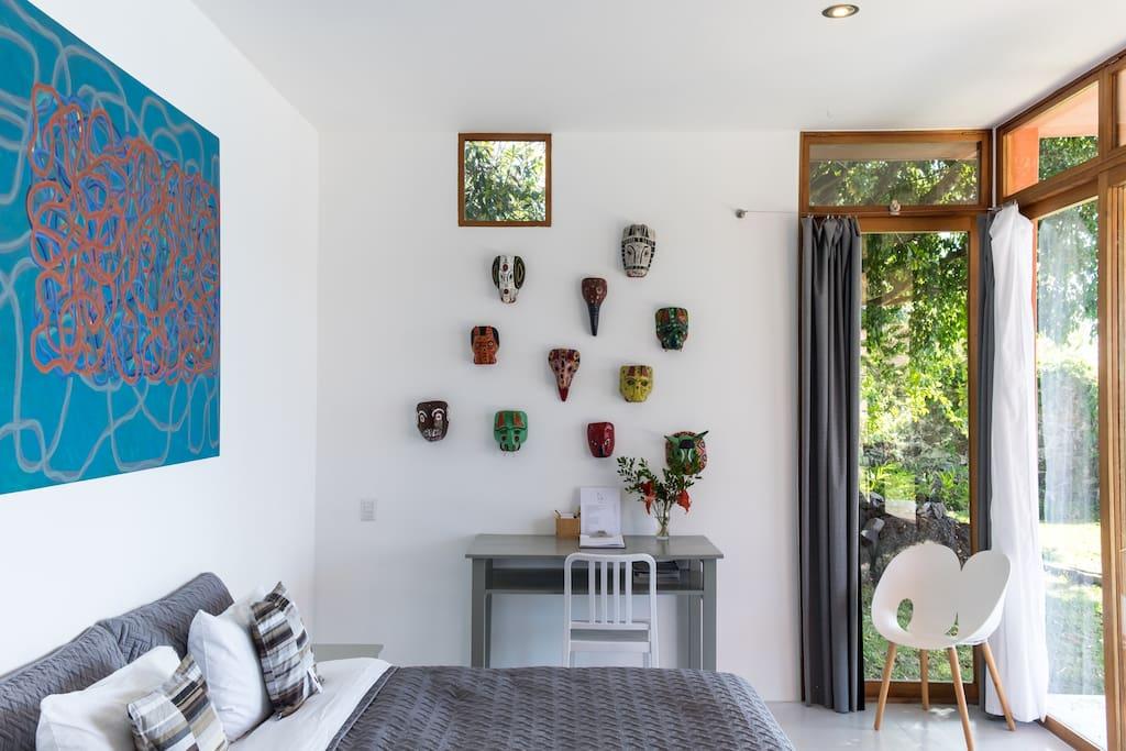 Suite Three -  spacious king deluxe bedroom, hardwood floor, high ceiling, large sliding door opens to the terrace with hammock