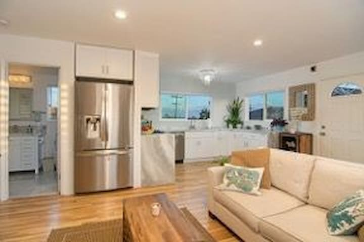 Open kitchen, dining and living room flooded with light and ocean breezes!