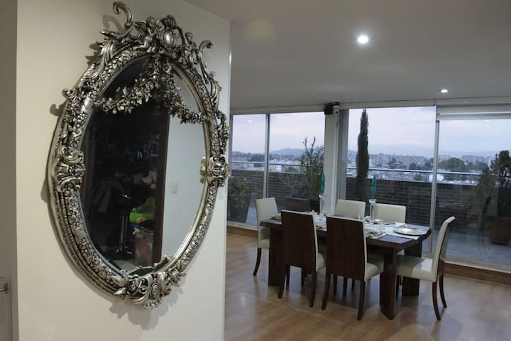 We have a very comfortable living room with an amazing view of the north of the city and the mountains (the apartment is a penthouse at  the 11th floor)