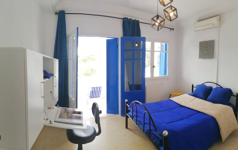 Room in an apartment with private beach