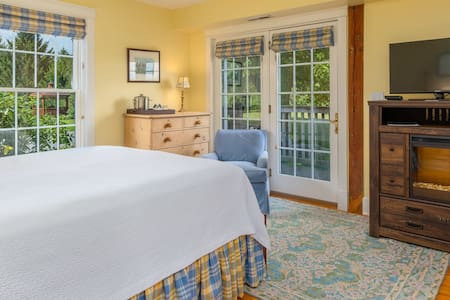 Queen room with electric fireplace, flat screen tv, private porch and private bathroom.