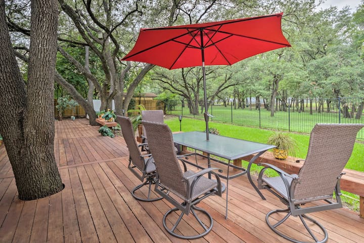 The wooden deck overlooks the lush garden, park and hot tub.