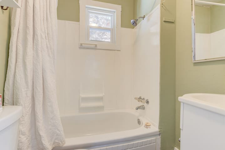 Very small but clean bathroom with a tub/shower combo.