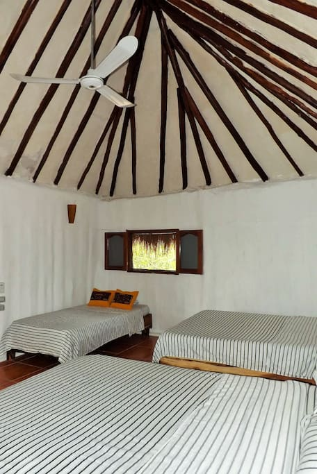 The three beds, 2 double bed and one single bed.