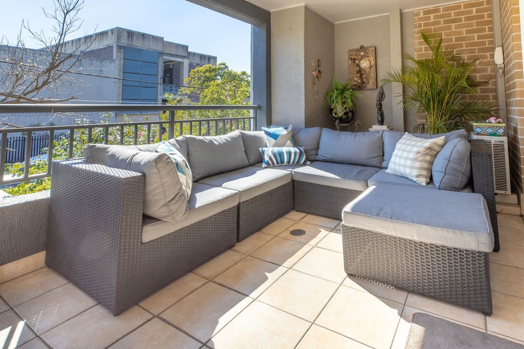 The large balcony off the living area serves as a terrace with comfortable  sofa/lounge seats