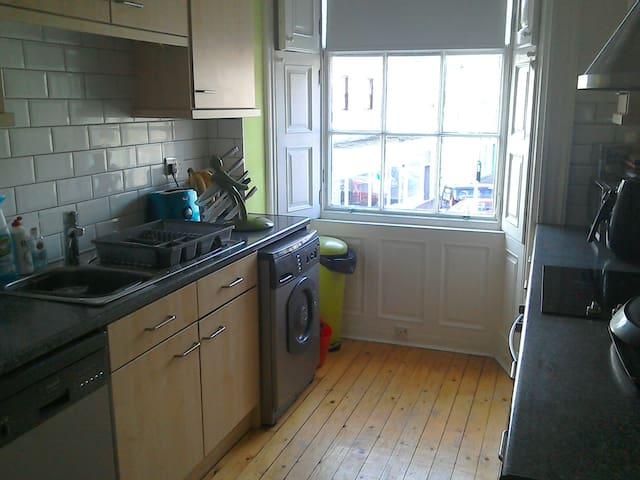 Spacious kitchen - washing machine, large fridge, dishwasher and electric cooker.