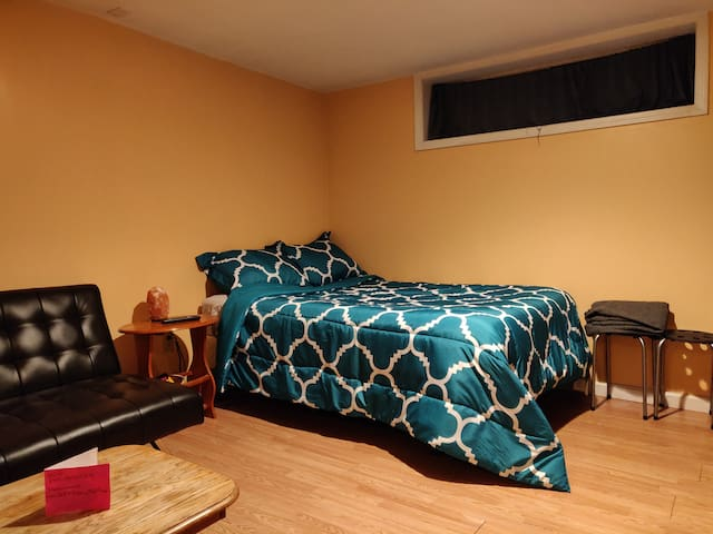 Full size bed with Convertible Futon next to it!