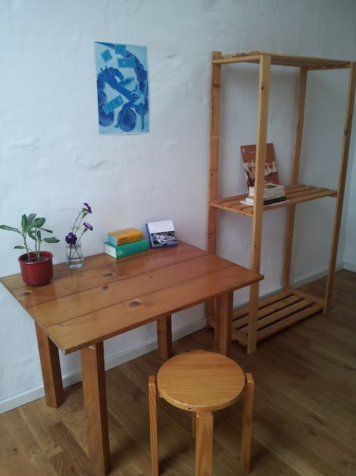 Working/writing desk and shelves for clothes or books.