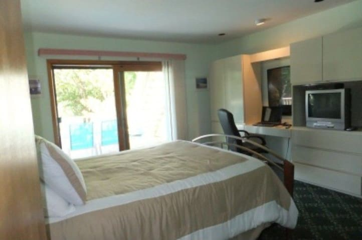 Bedroom with private deck overlooking the heated pool.