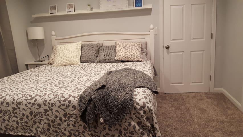 King-size bed in an en-suite bedroom.