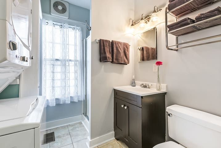 Second full bathroom has shower stall and laundry washer & dryer. Amenities also included.