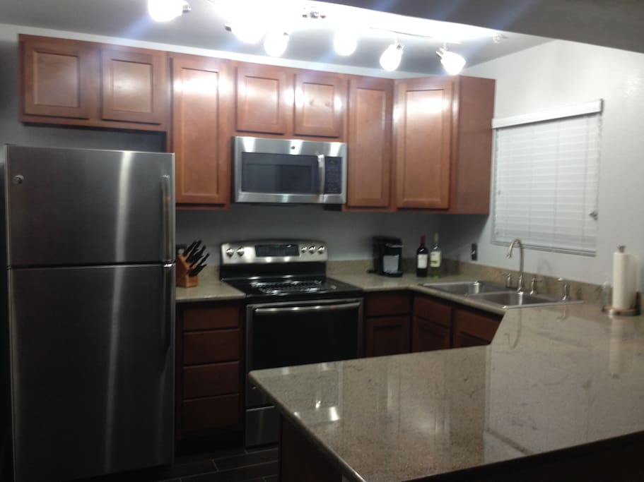 Kitchen: granite countertop and stainless steel appliances. Coffee maker,