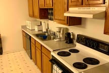 Angle from laundry room showing stove CanOpener coffee maker microwave etc. coffee is always provided