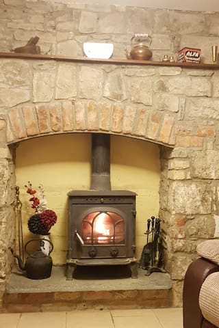 Cosy sitting room with wood burning stove