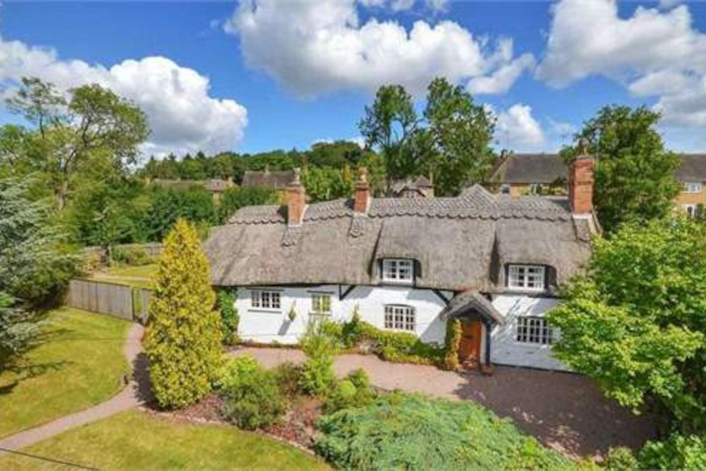 Tumbledown Cottage nestled in picture perfect village