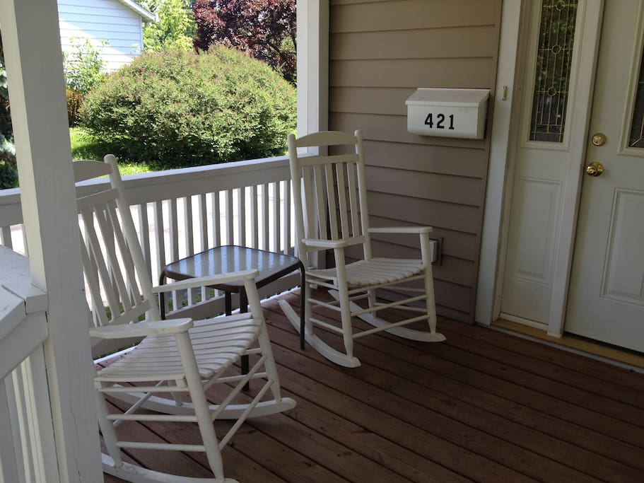 The front porch has seating to enjoy conversation and morning coffee.