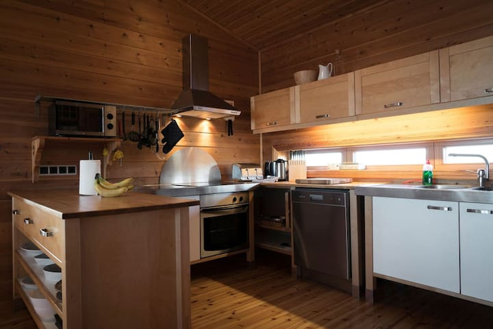 Fully equipped kitchen; cutlery, fridge, freezer, oven, stove,  fan, microwave, dishwasher, kitchenaid mixer, waffle iron, sandwich grill, BBQ...