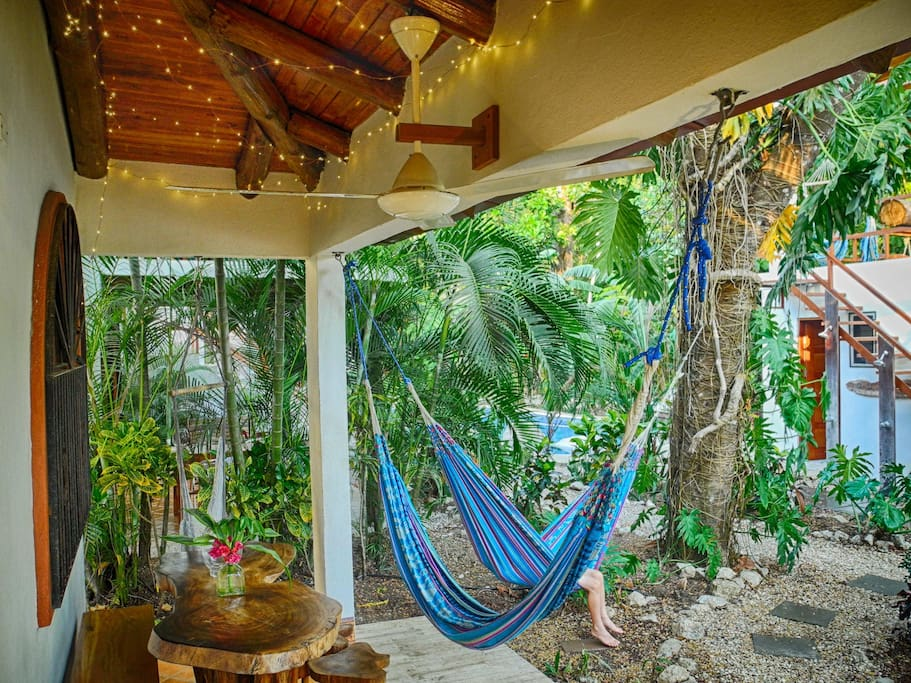 Enjoy hammocks on your patio while you look out to the garden and out to the pool, steps away.