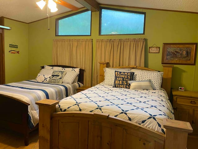 """This is the """"Master Bedroom"""" and it has a queen size bed and a full size bed, along with an en-suite bathroom with walk-in shower."""