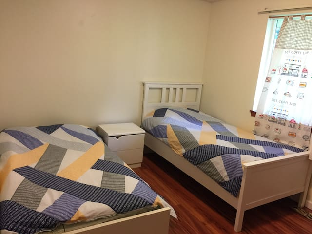 Clean Cozy Two Twin Beds
