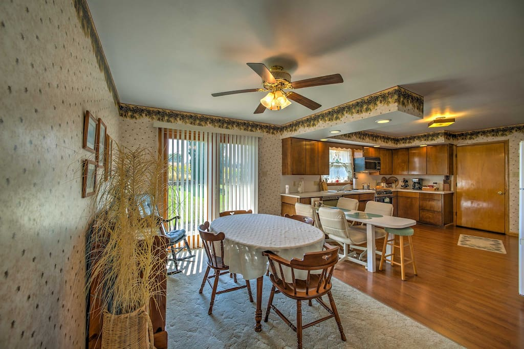 The home offers a fully equipped kitchen and charming dining area.