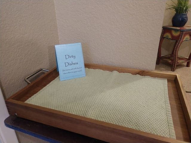 Dirty Dish tray, right outside your door.  Simply put dirty cups, glassware or french press on this tray and I will clean and return them for your next use.