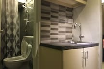 First Floor: Bathroom 1 and kitchen sink across