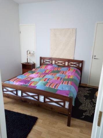 Bedroom. View from livingroom kitchen door.