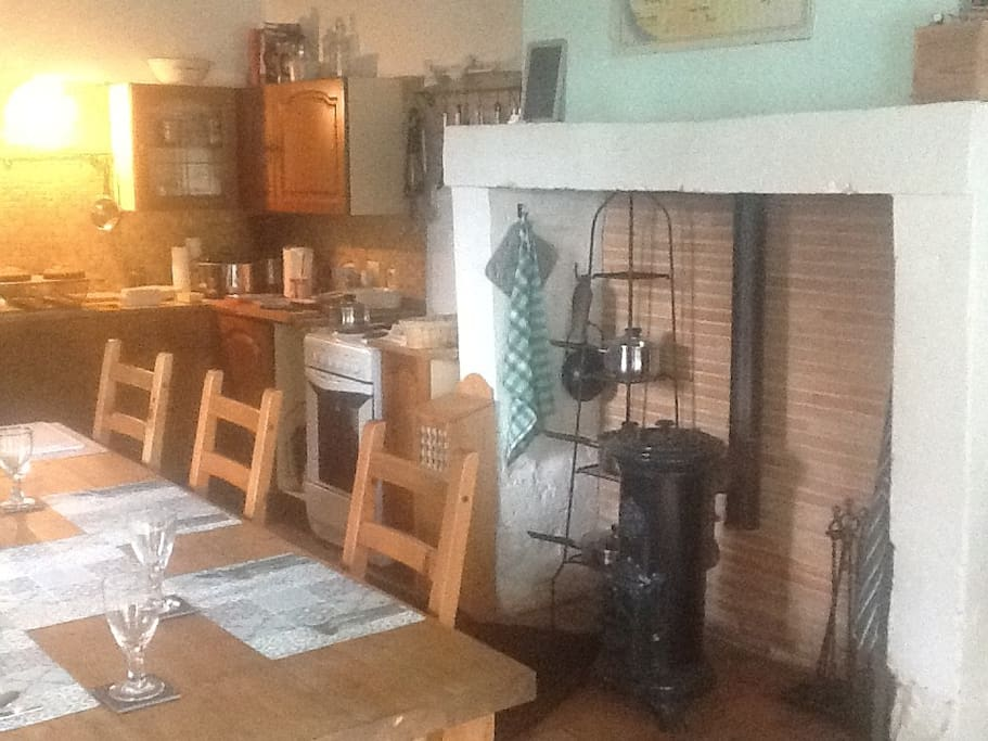 Dining room with large fireplace anf wood burning stove