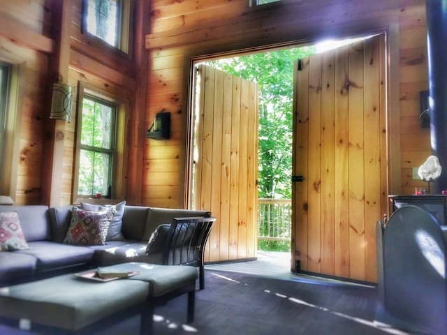 View us on ANIMAL PLANET we are the Kentucky Climbers Cottage Here shows the barn doors opening to the view.