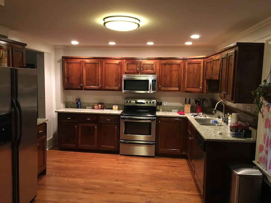 Enter Into a Large Kitchen with all Appliances, Washer, Dryer, and Delicious Jittery Joes Coffee.