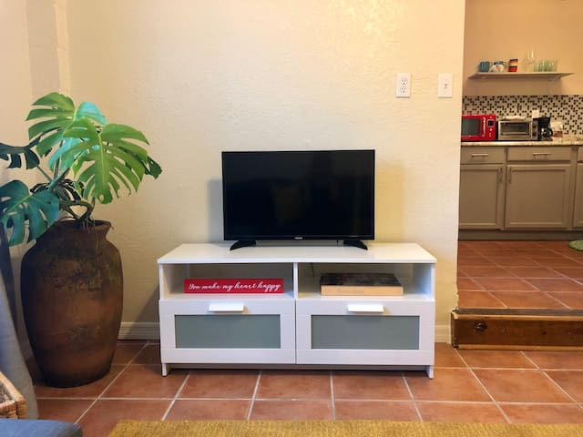 Smart TV includes Netflix, PrimeVideo, Hulu+Live cable TV. There are drawers underneath the TV table if you want to store anything there. And a lovely art coffee table book for you to look through.