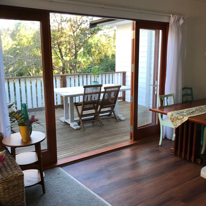 Modern living area opening on to large deck