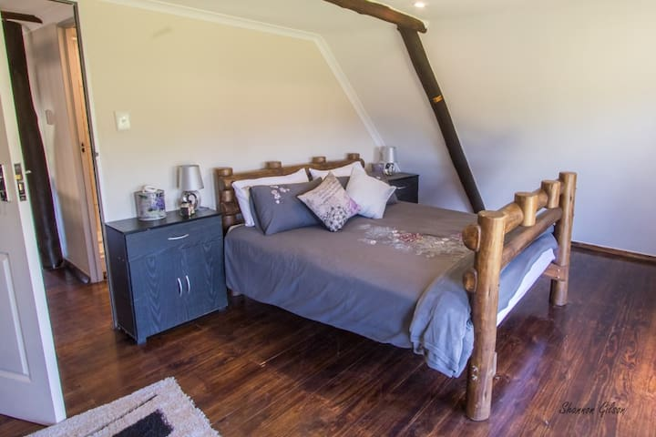 Main Suite Upstairs with Faux Leather Sleeper Couch & HDTV with Full DSTV