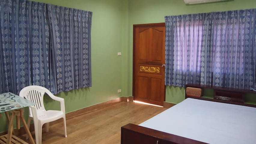 The second bedroom is also spacious. It has a queen sized bed, A/C and a desk. Its balcony also opens onto the street.